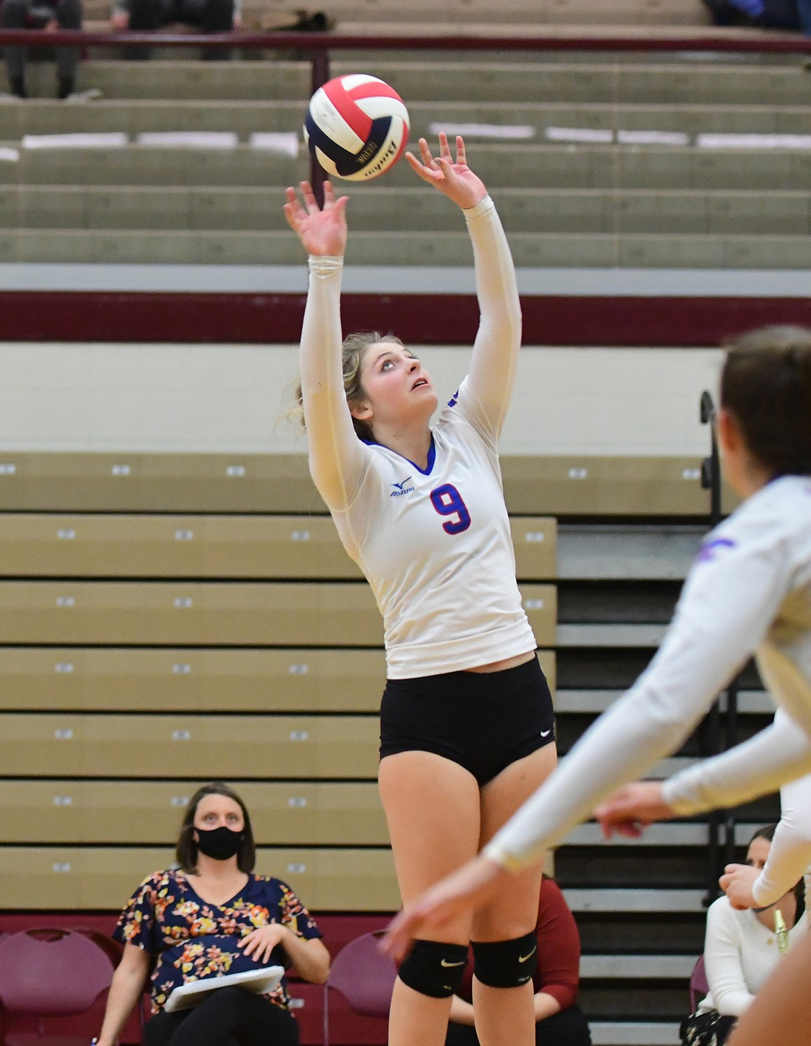 Hannah Schweikert sets her teammates up for the kill during Friday's match against Corvallis. (Teresa Byrd/Hungry Horse News)
