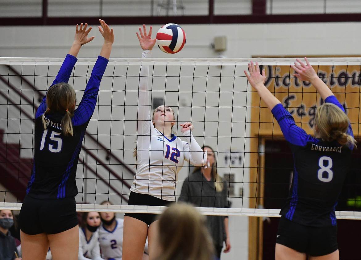 Lauren Falkner spikes the ball past the Blue Devils in a match against Corvallis last Friday. (Teresa Byrd/Hungry Horse News)