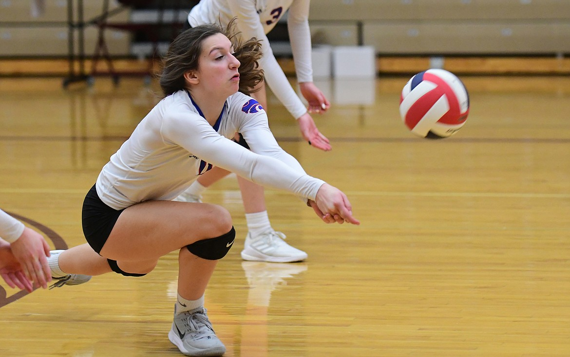 Jazzy Marino lunges for the dig in a match against Corvallis at the state tournament last Friday. (Teresa Byrd/Hungry Horse News)