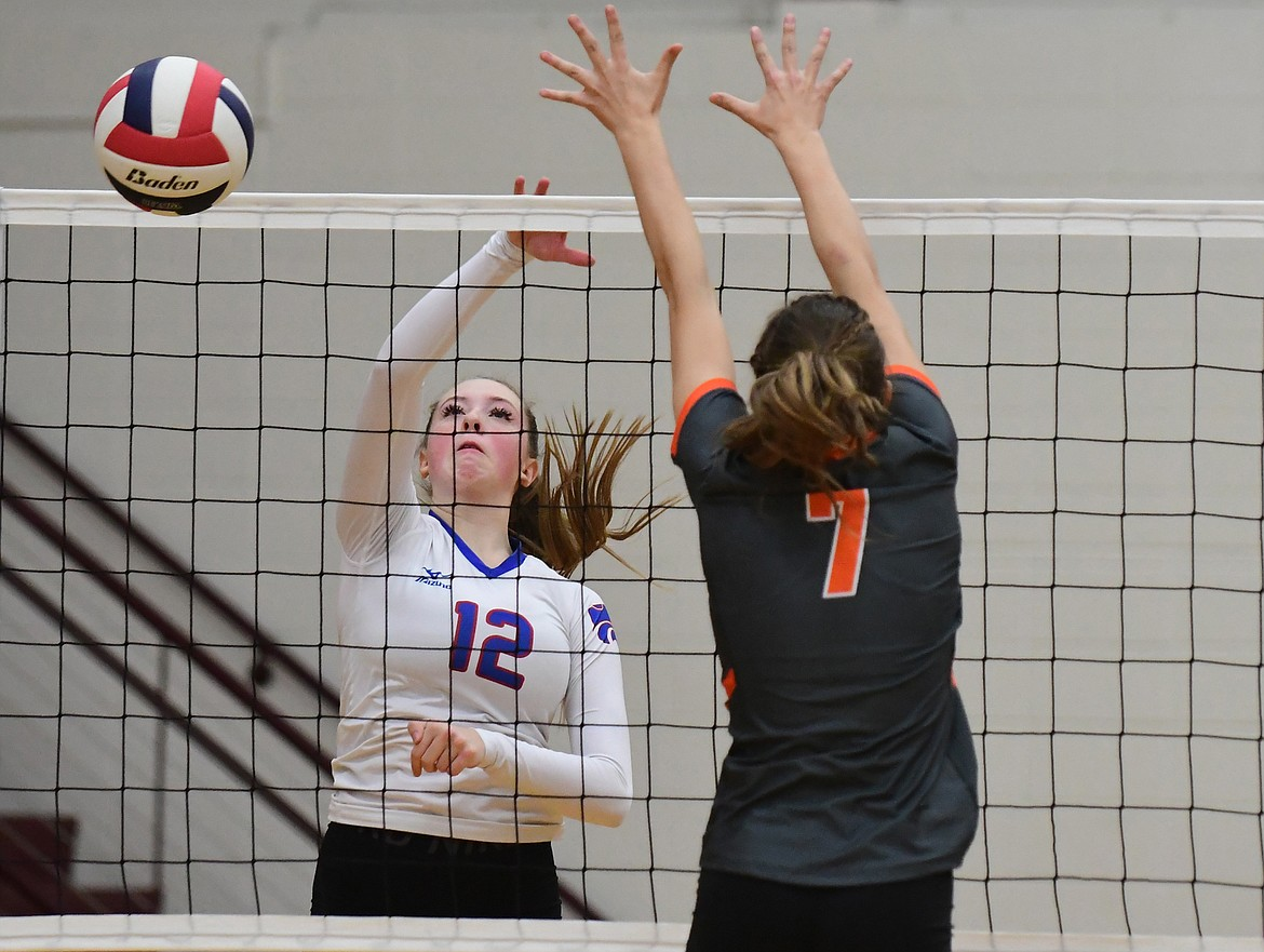 Lauren Falkner spikes the ball past Hardin in their second match of the state tournament last Thursday. (Teresa Byrd/Hungry Horse News)