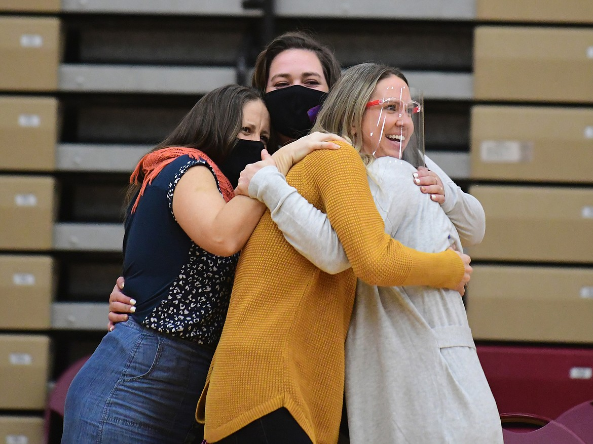 The Wildkat volleyball coaches huddle in a celebratory hug after the Kats came back to beat Hardin which landed them in the championship match. (Teresa Byrd/Hungry Horse News)