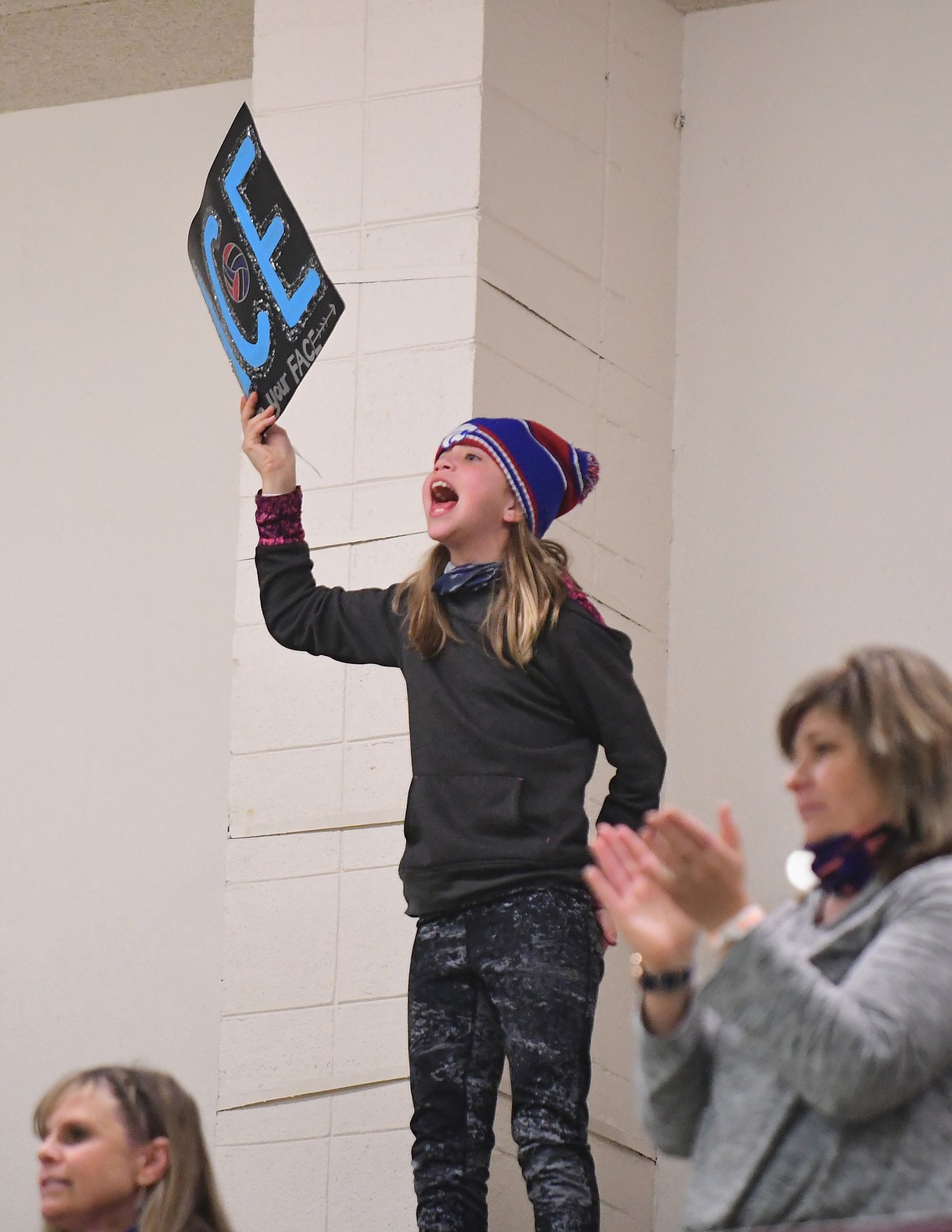 Jezanie Brooks stokes fan spirit for the Wildkats during the State A volleyball tournament in Sidney last week. (Teresa Byrd/Hungry Horse News)