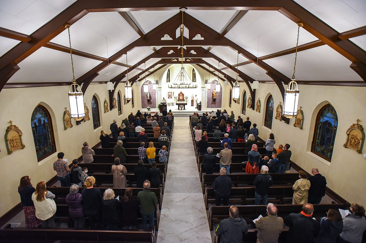 Parishioners stand during Mass at St. Matthew's Catholic Church in Kalispell on Saturday, Nov. 21. (Casey Kreider/Daily Inter Lake)