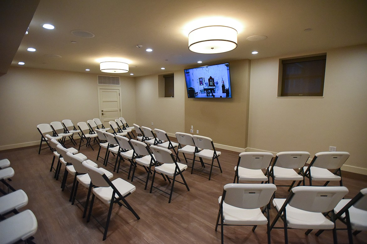 The renovated downstairs features a sitting area with a livestream of the proceedings during Mass at St. Matthew's Catholic Church in Kalispell on Saturday, Nov. 21. (Casey Kreider/Daily Inter Lake)