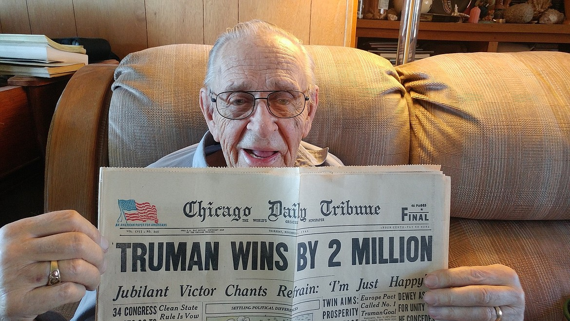 """Robert Larsson, 91, of St. Ignatius submitted this photo of the copy of the Chicago Tribune he purchased for 4 cents on Nov. 4, 1948. The story reads: """"In the most dramatic election in American history a landslide vote on Tuesday swept President Truman into office for another four years."""" The previous day, it was assumed that New York Gov. Thomas E. Dewey had won. By Thursday, Truman had been declared the winner. (Courtesy of Robert Larsson)"""