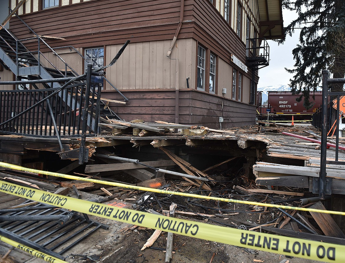 The decking and electrical infrastructure at the historic train depot in Whitefish sustained extensive damage when a vehicle rammed into the structure Sunday morning. The driver, Courtney Holler, of the Whitefish area, was airlifted to a Seattle hospital. Authorities are investigating the crash. (Heidi Desch/Whitefish Pilot)