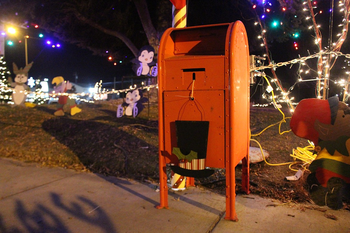 Letters to Santa Claus were dropped off at the Quincy Christmas celebration on Friday night. The box will sit out front of the Chamber of Commerce throughout the month for anyone who wasn't able to drop their letter off on Friday.