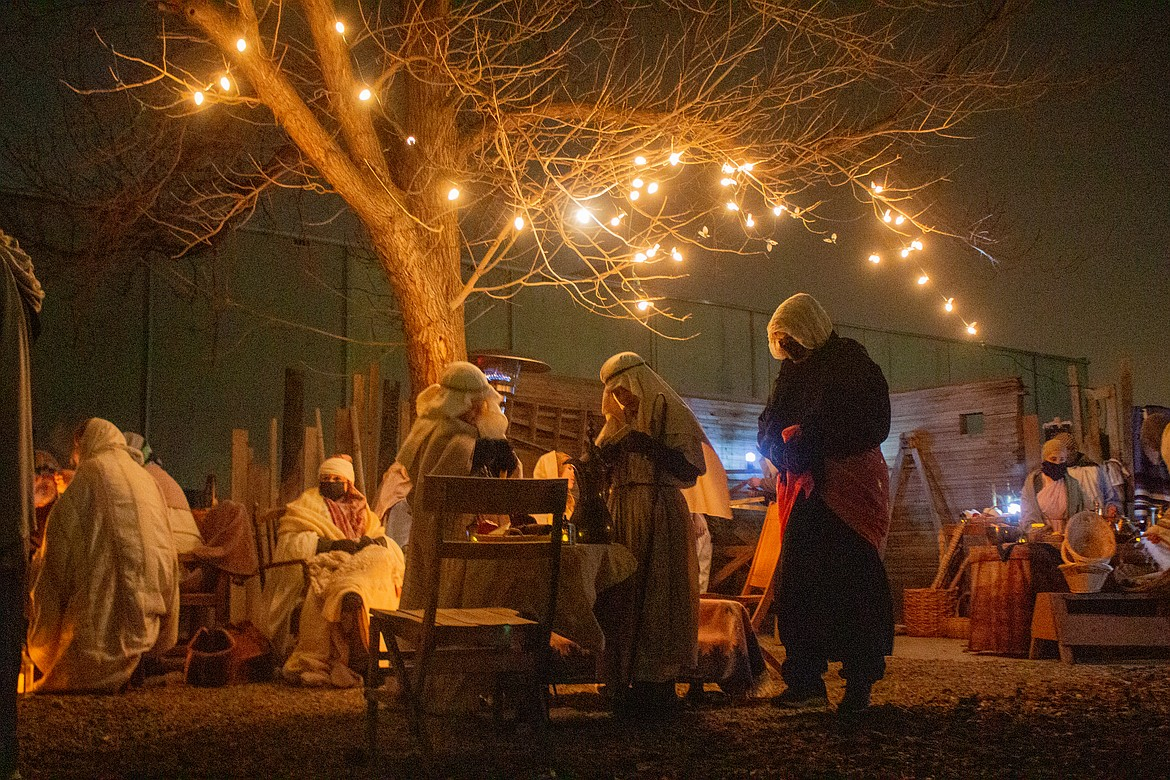 Youth group members and volunteers from the Faith Community Church in Quincy bring the town of Bethlehem to life at the Living Nativity event on Saturday night in Quincy.