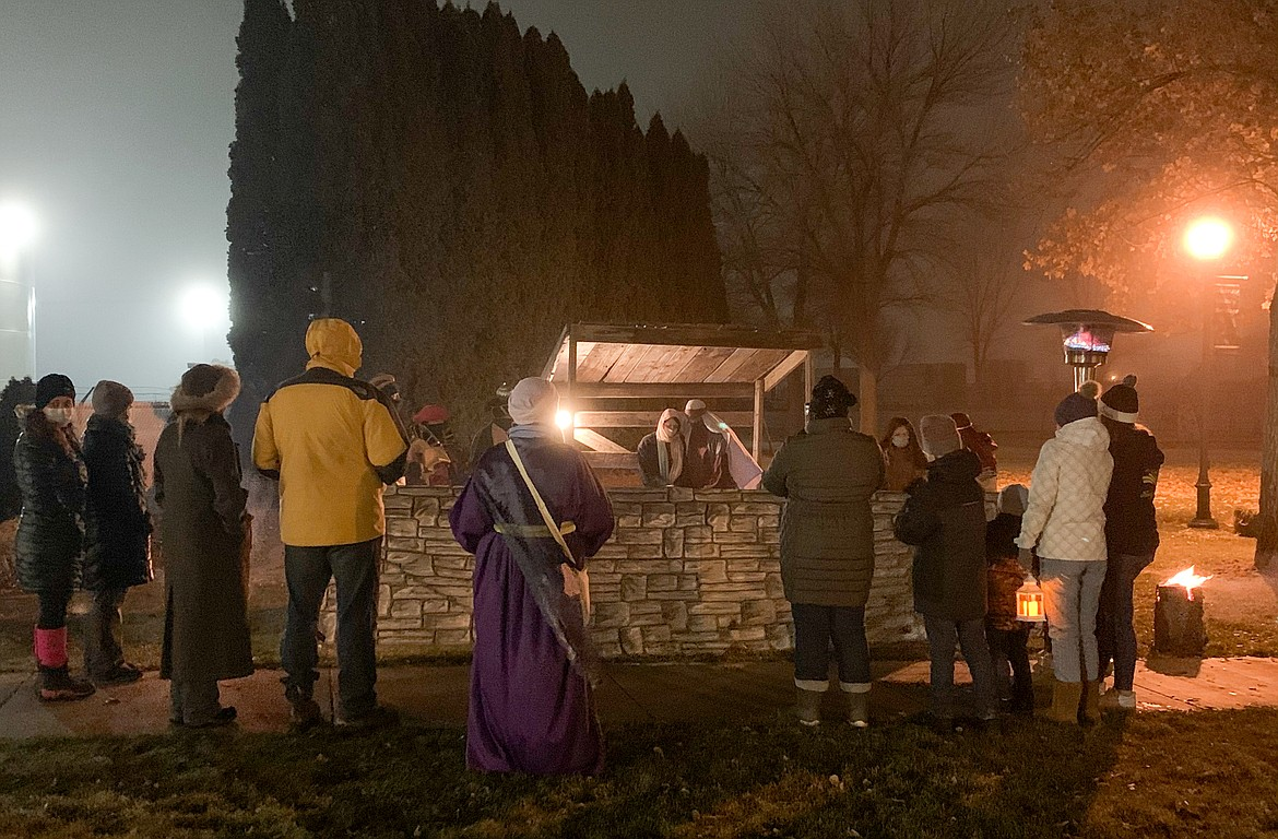 Visitors gather around the Nativity scene at the Living Nativity event at the Quincy Historical Society & Museum on Saturday night.