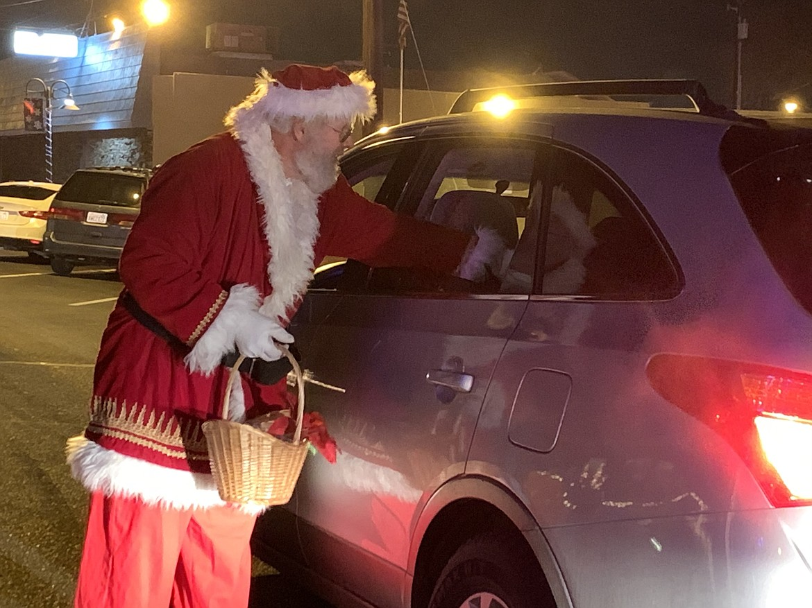Santa Claus handed out candy canes and received Christmas wish letters from children in downtown Quincy as the Quincy Valley Holiday Celebration kicked off on Friday night.