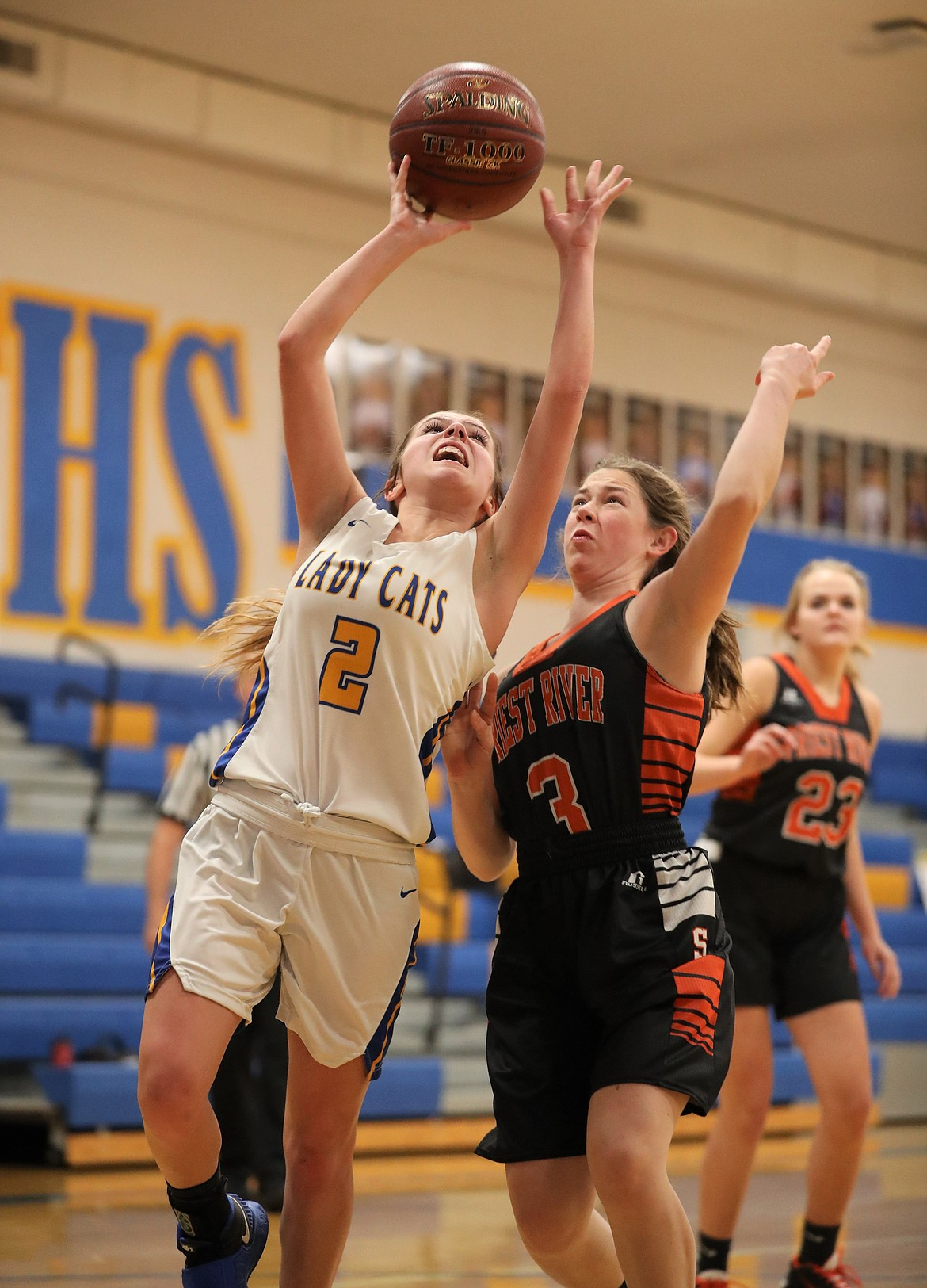 Clark Fork's Paige Valliere (left) attempts a shot while Priest River's Annika Rantala defends her on Friday.