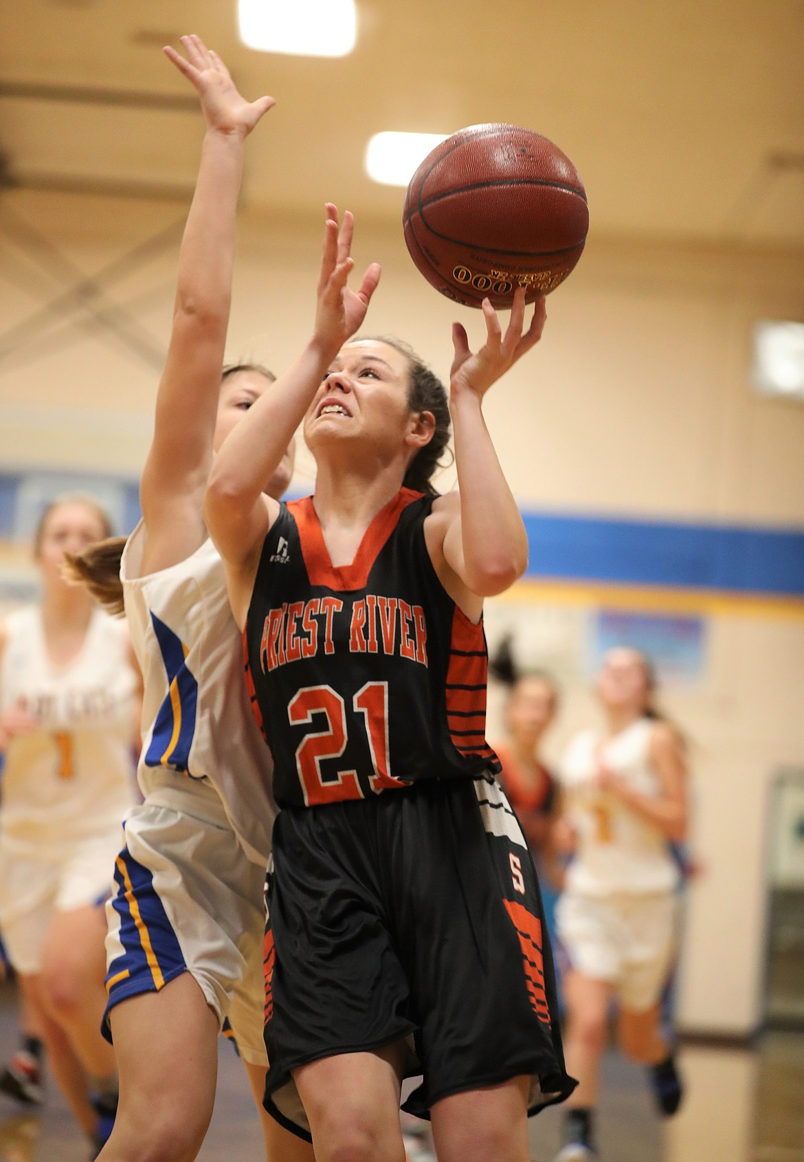 Priest River senior Hannah Palfrey (right) fights to put up a shot over Clark Fork's Eloise Shelton.