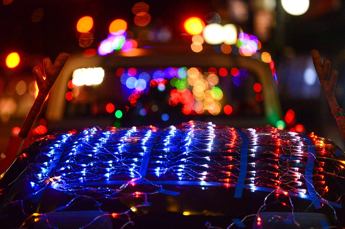 Christmas lights in the design of an American flag decorate a car at the Elevation Christmas Light Car Show in downtown Kalispell on Saturday, Dec. 12. (Casey Kreider/Daily Inter Lake)