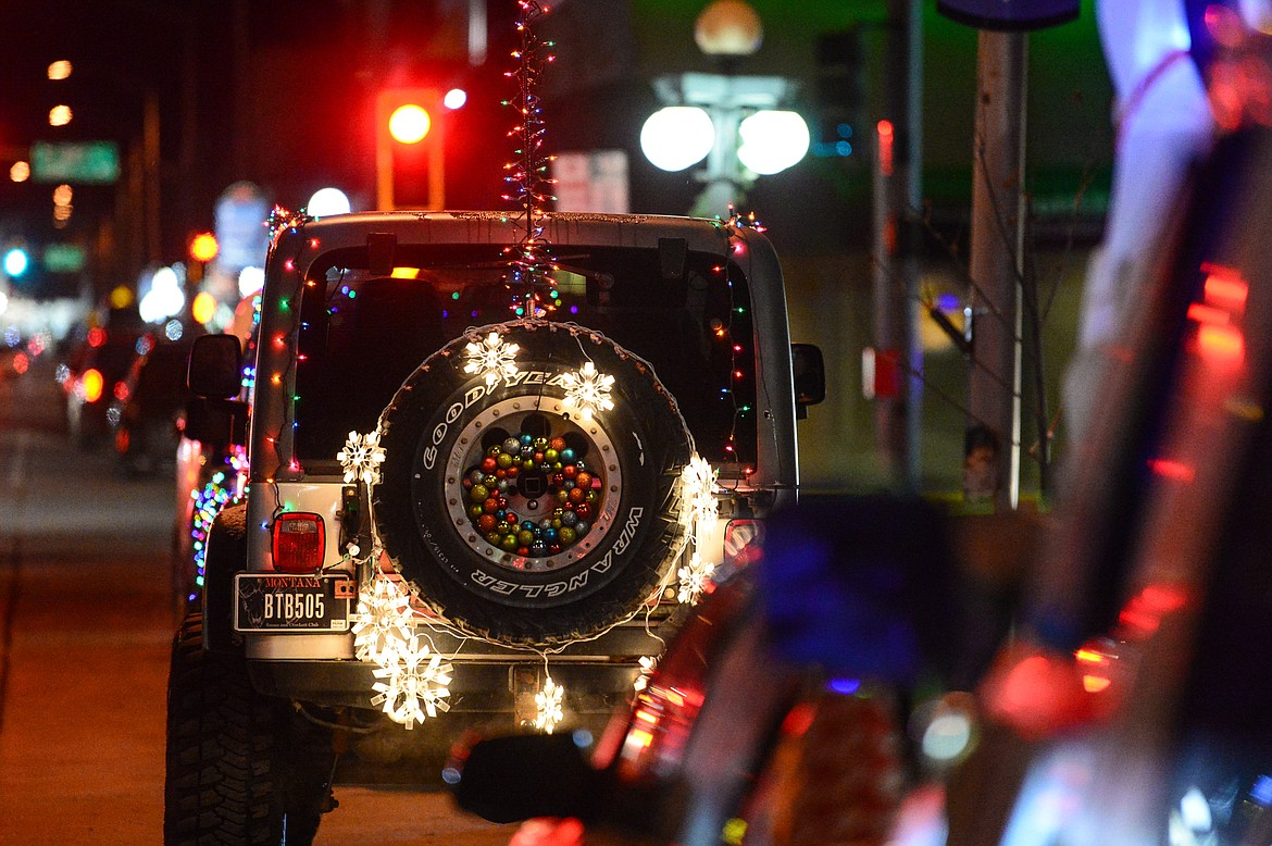 Christmas lights decorate a Jeep at the Elevation Christmas Light Car Show in downtown Kalispell on Saturday, Dec. 12. (Casey Kreider/Daily Inter Lake)