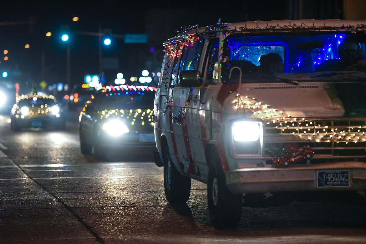 Vehicles decorated with Christmas lights cruise down Main Street at the Elevation Christmas Light Car Show in downtown Kalispell on Saturday, Dec. 12. (Casey Kreider/Daily Inter Lake)