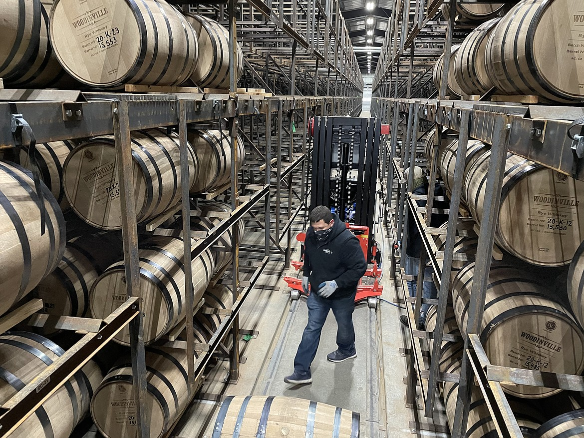 Elijah Gregg racking barrels at one of Woodinville Whiskey Co.'s Quincy warehouses.