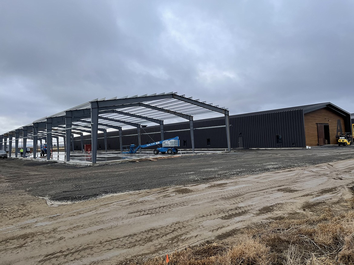 Woodinville Whiskey Co. is building a third warehouse to age bourbon and rye whiskey southwest of Quincy.