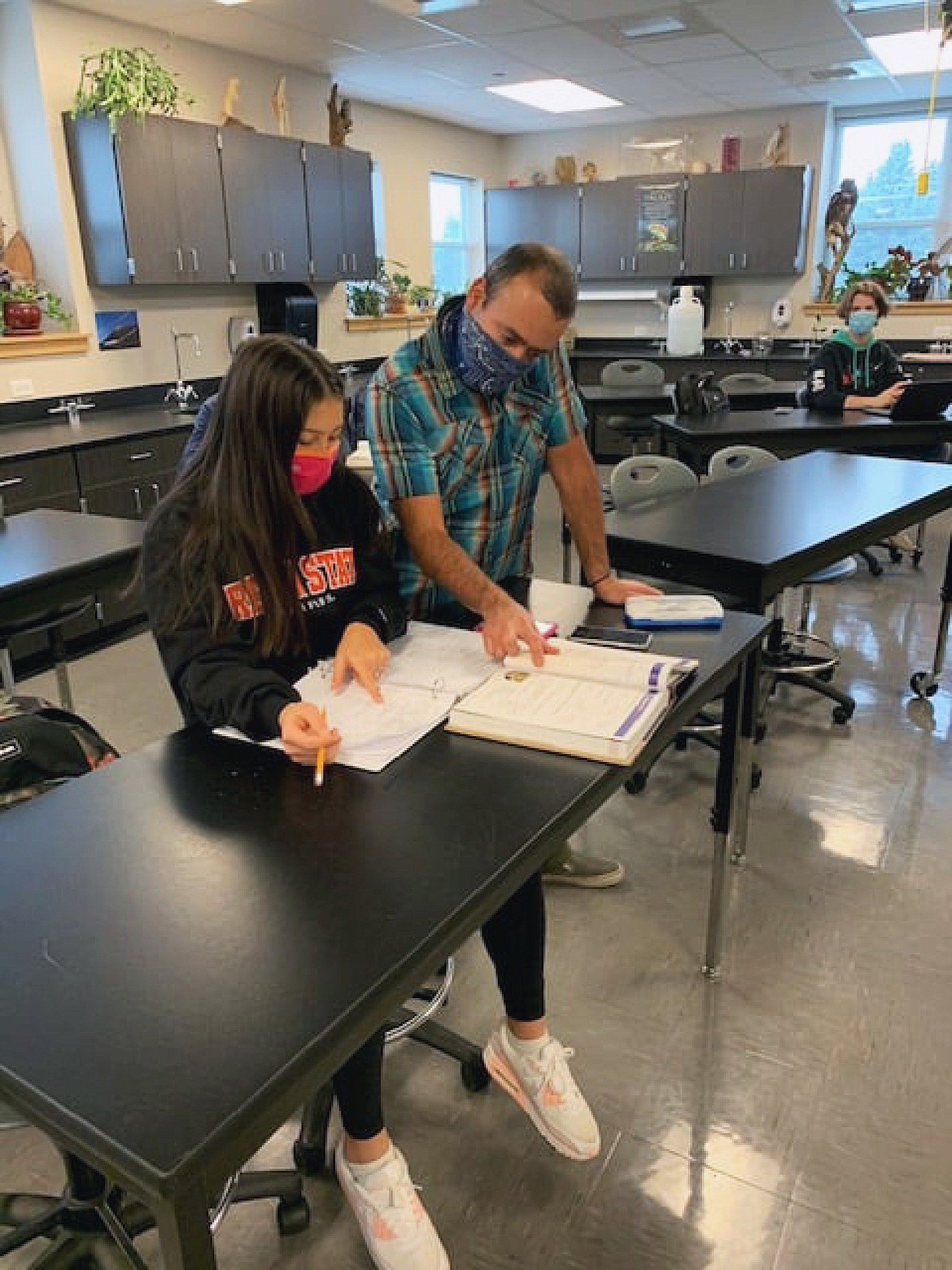 Whitefish High School sophomore Ava Mendoza works on geometry with her math teacher Damian Estrada on a recent Wednesday at the high school. (Photo courtesy of Whitefish School District)