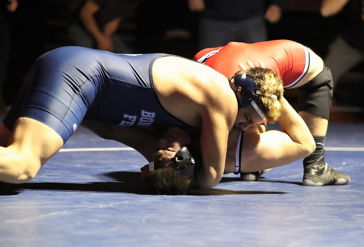 """Isaiah Shottanana (top) pins Sandpoint's Tag Benefield in a 220-pound bout last Thursday. The victory helped Bonners Ferry reclaim the """"B"""" Cup."""