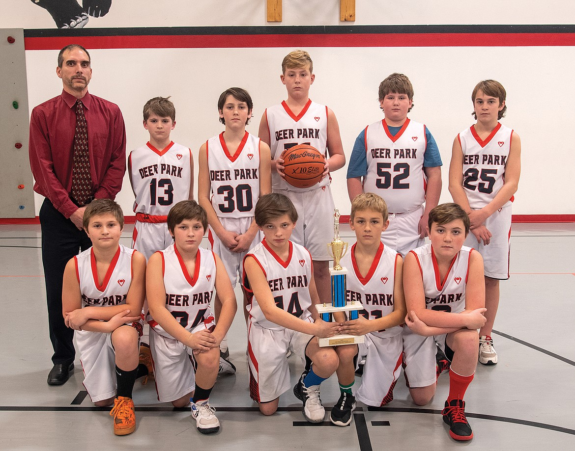 The Deer Park fifth and sixth grade basketball team recently won the county small school championship under the guidance of coach Robert Hall. Front row, from left is Jaxson Caldwell, Hunter Strandberg, Hayden Strandberg, Hunter Perry; back row coach Hall, Willem Pedersen, Jory Hill, Rhett Linskoog, Blayze McCracken and Tyson Bessen. Not pictured is Eli Crockett and Eddie Read. The boys beat Homeschool 50-13 and had a 14-0 record.