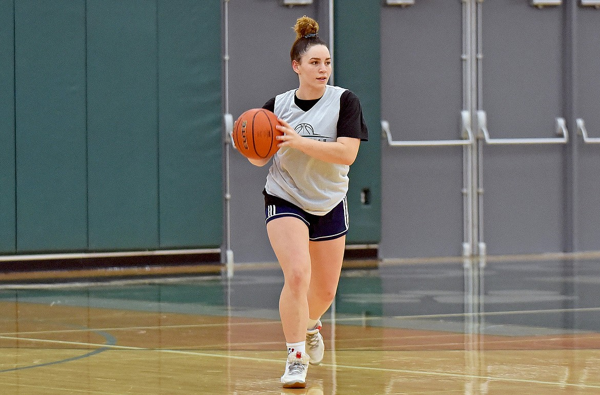 Lady Bulldog senior Gracie Smyley looks to pass the ball during a drill at the girls basketball practice on Dec. 10. (Whitney England/Whitefish Pilot)