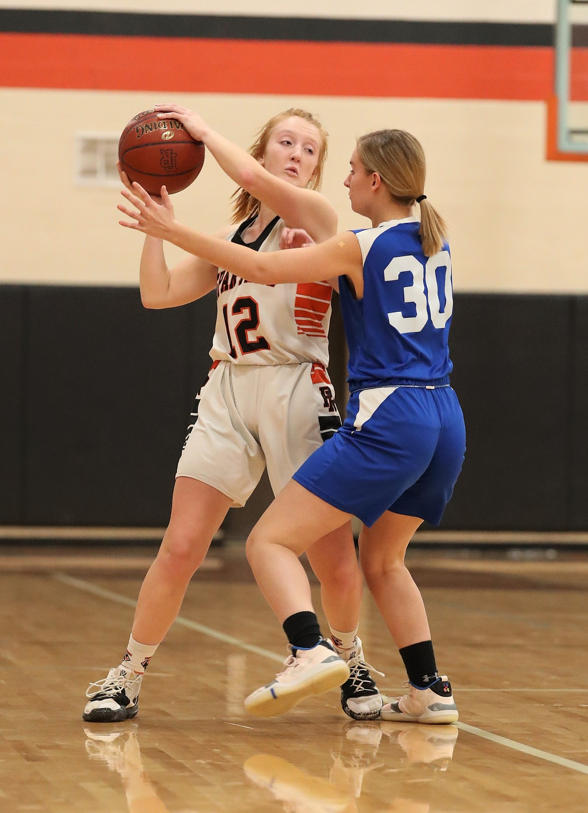 Makia Fitzmorris tries to find an open teammate on Monday night.