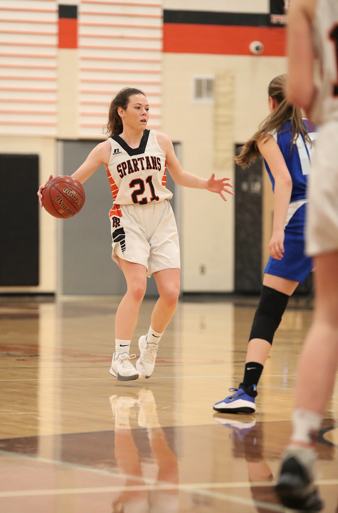 Senior Hannah Palfrey brings the ball up the court on Monday night.