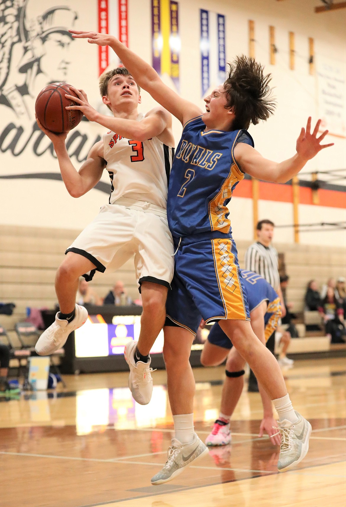 Junior Jordan Nortz attempts to hit a contested shot over a North Idaho Christian defender on Monday.