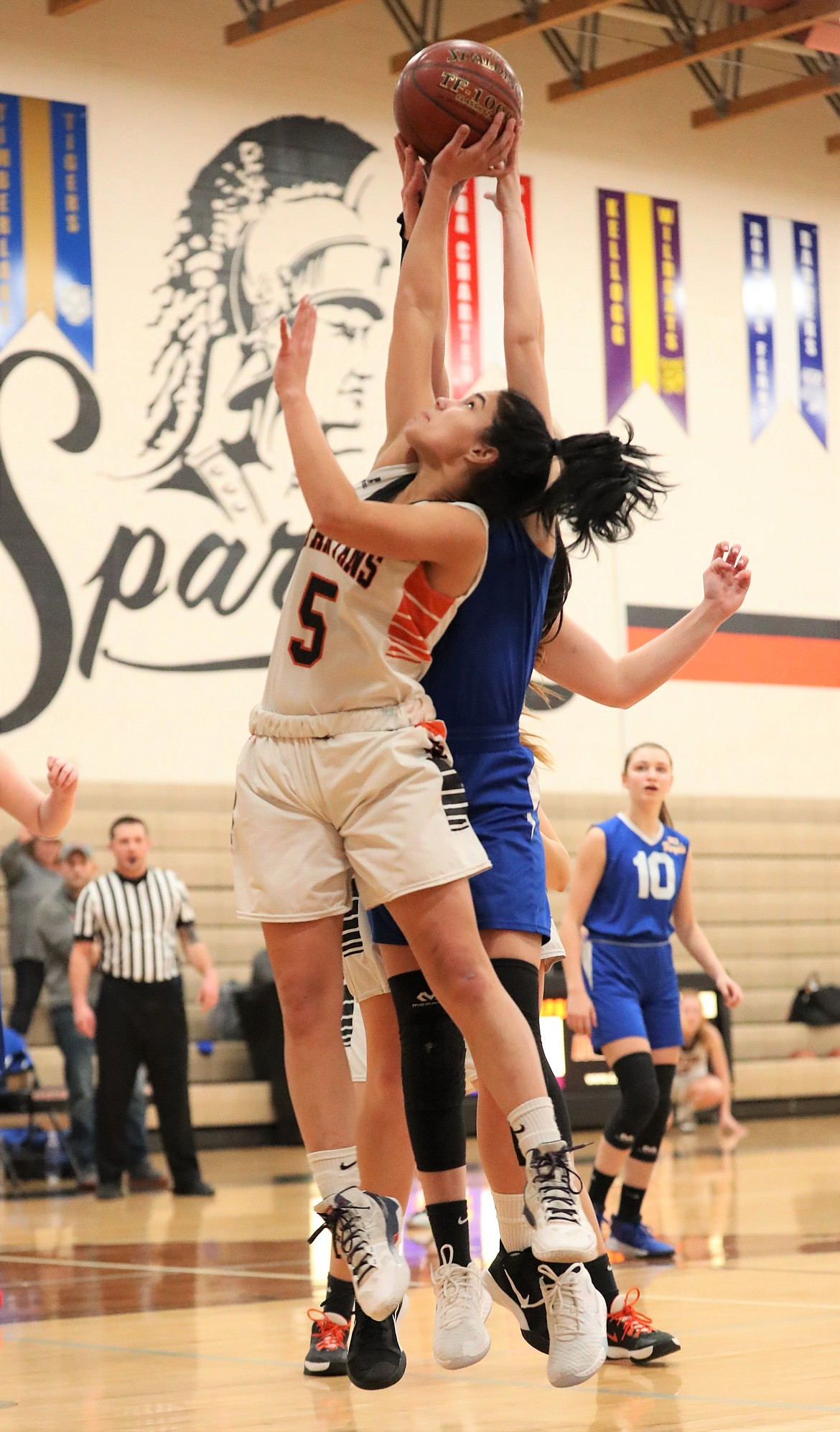 Sophomore Lilly Freitas fights for a rebound with a North Idaho Christian defender on Monday.