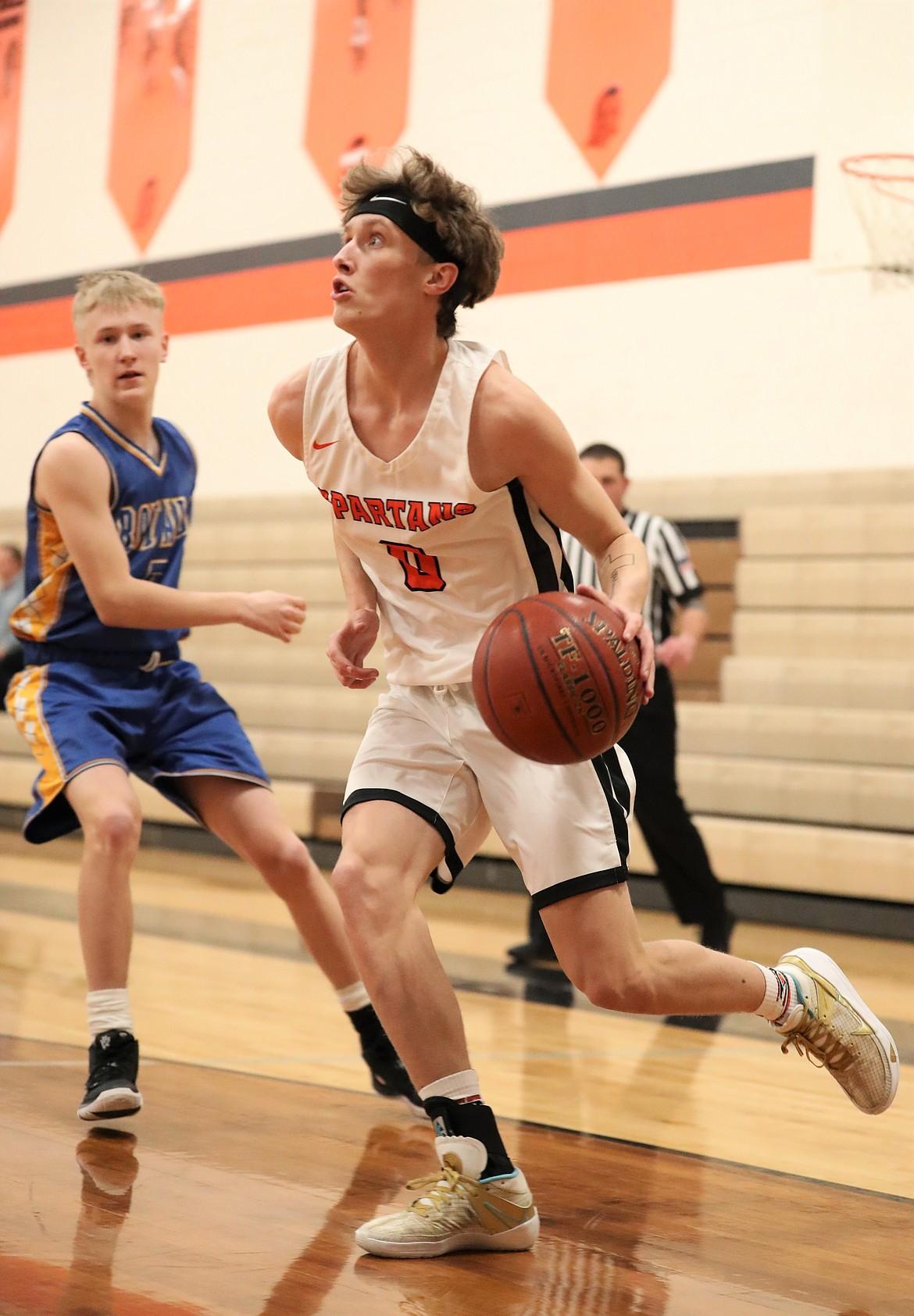 Junior Travis Mathews drives toward the basket during Monday's game.