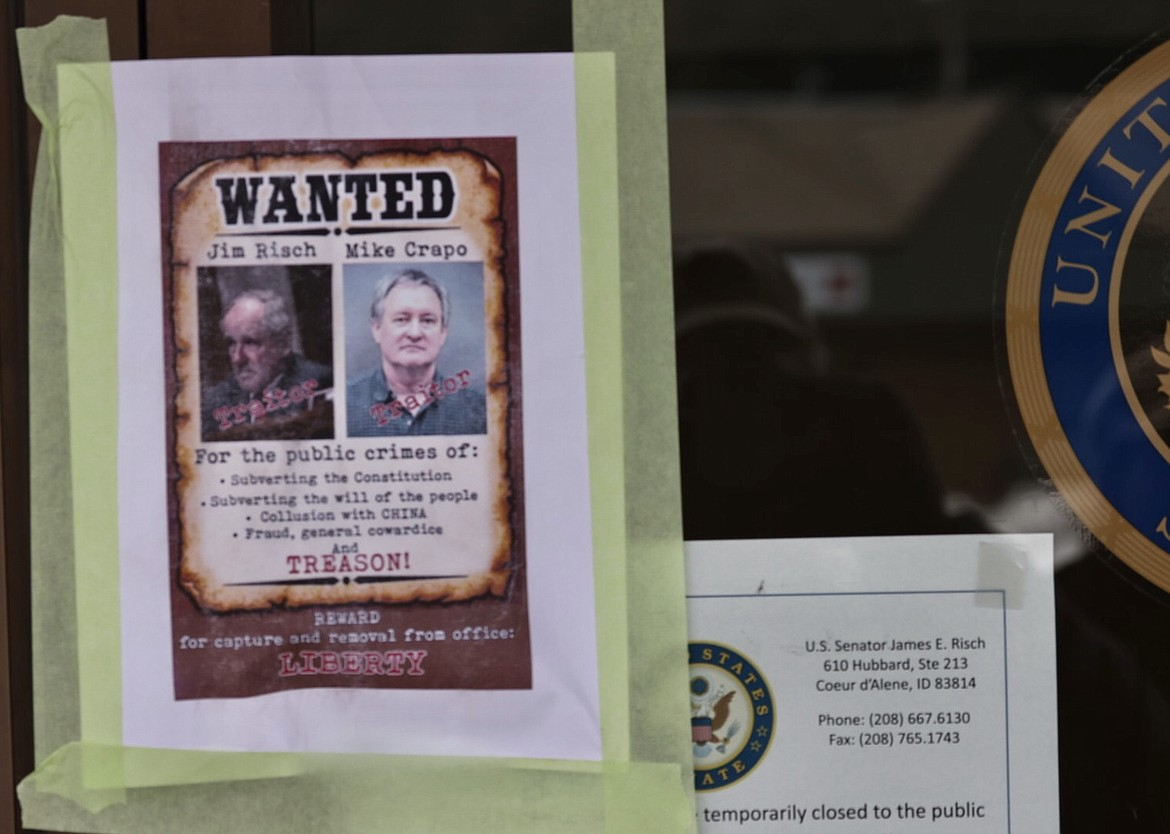Photo courtesy of Duane Rasmussen  Trump supporters taped posters and signs on Sen. Jim Risch's Coeur d'Alene office at the end of a rally Tuesday.