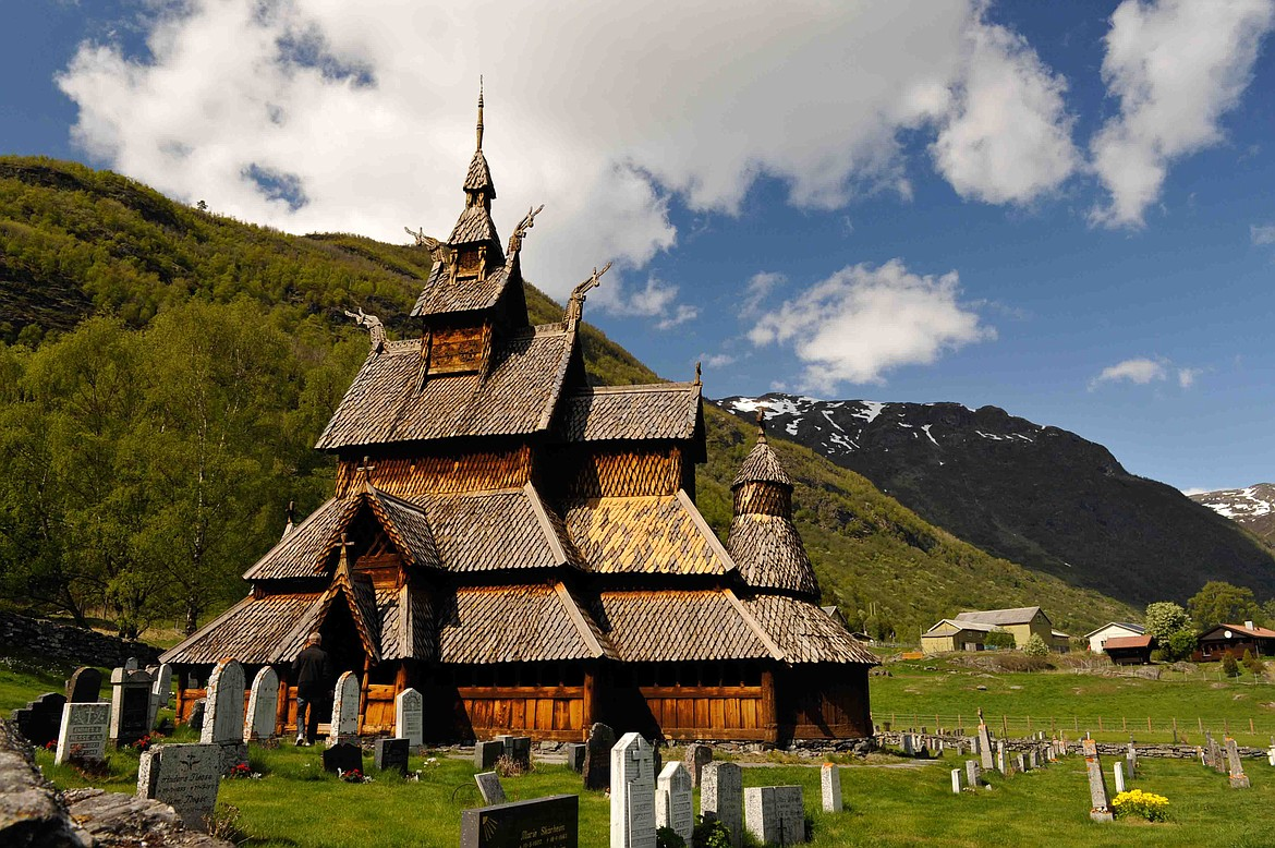 """The wooden Borgund Stave Church (now a museum) 150 miles north of Oslo, Norway, was built in 12th century, the interior featuring """"a curious mix of Christian and Norse décor,"""" including carved dragon heads used on bows of Viking ships."""
