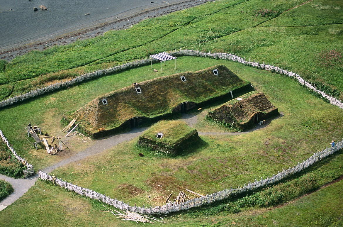 Reconstruction of Viking longhouse and smaller buildings at L'Anse aux Meadows in Newfoundland, site of the first European settlement in North America nearly 500 years before Columbus.