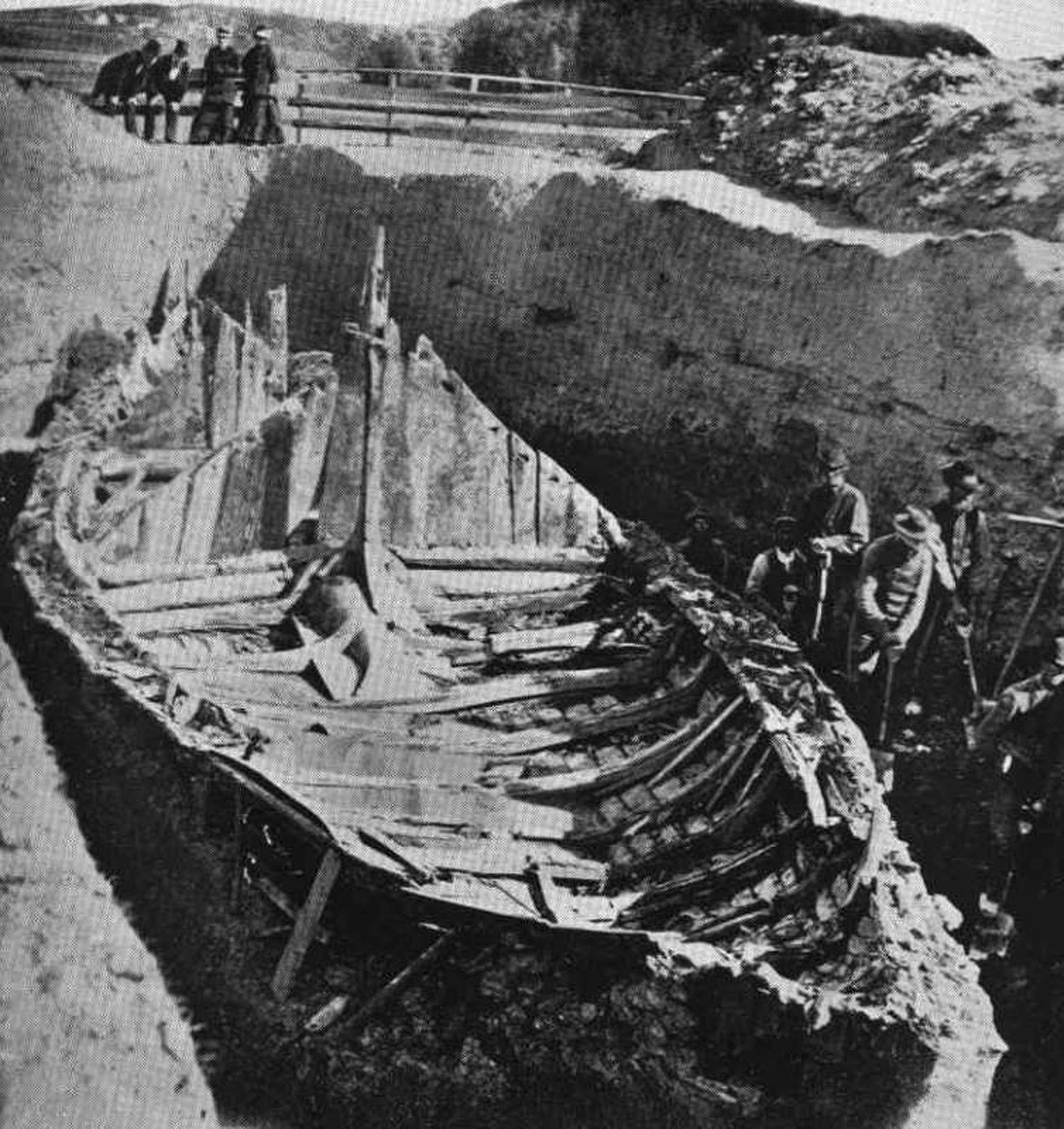 The 78-foot long Gokstad Viking ship was discovered buried on a farm near Oslo in 1880, apparently a funerary ship, with remains of a middle-aged man in the hull, surrounded by remains of two peacocks, two goshawks, eight dogs and 12 horses (photo c.1880).