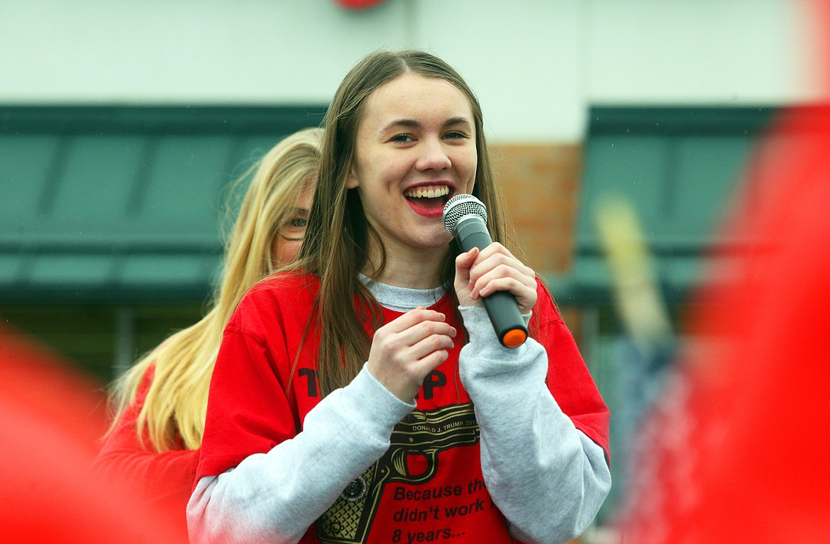 Ashlyn Murray talks to the crowd before singing the national anthem at Wednesday's pro-Trump rally in Coeur d'Alene.