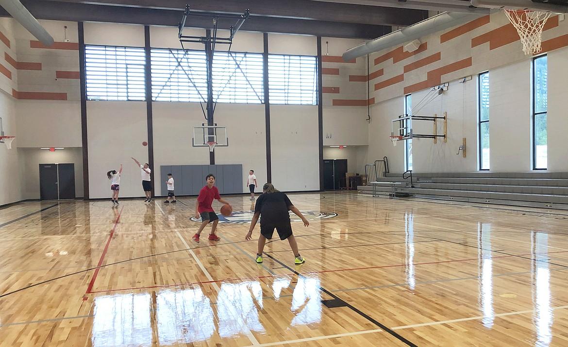 Hoksila Sakeema Iron Cloud dribbles the basketball on the court of the new Coeur Center in Worley.