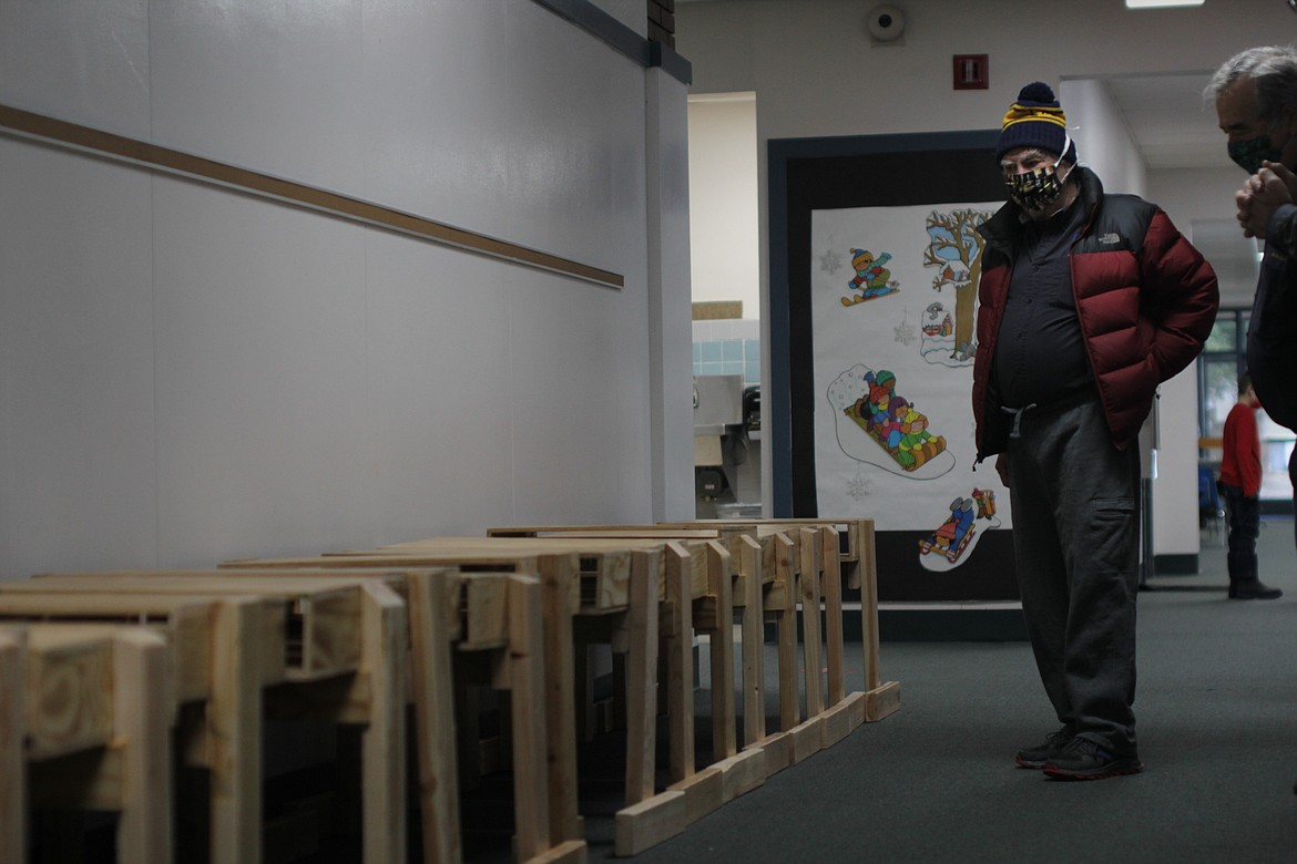 Rotary president Harry Loskill looks at the desks the group built for students Friday morning at Idaho Hill Elementary School.