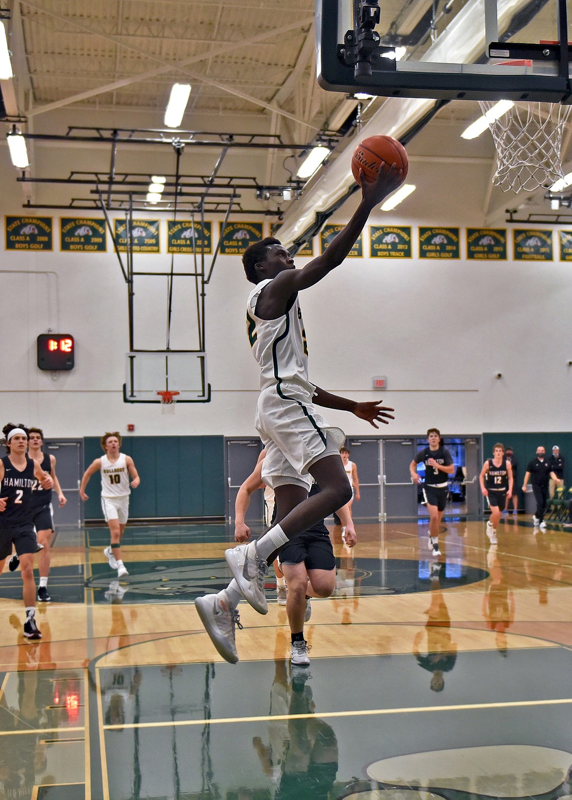 Whitefish senior Marvin Kimera gets out on the fast break for a layup against Hamilton on Saturday afternoon. (Whitney England/Whitefish Pilot)