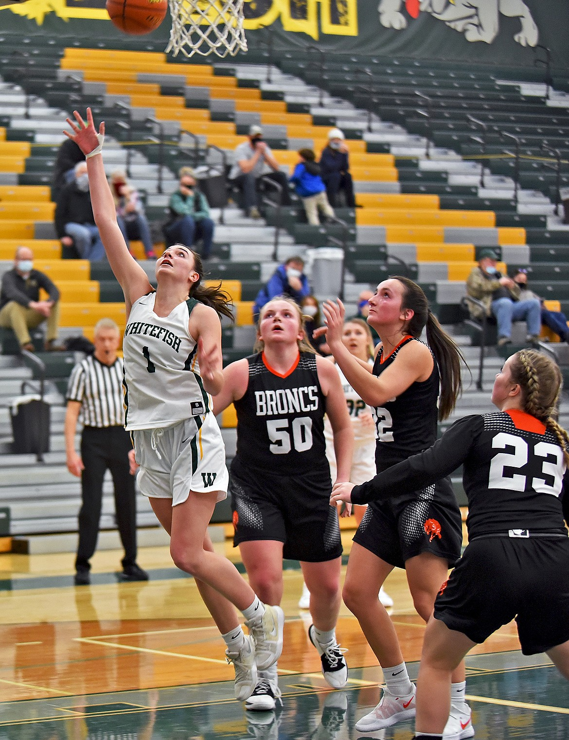 Lady Bulldog Jadi Walburn gets around Frenchtown's defense to score a layup during a game at Whitefish on Thursday evening. (Whitney England/Whitefish Pilot)