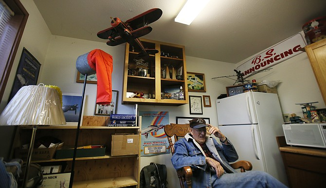 """Hangar owner Gene Soper, 91, adjusts his Coeur d'Alene Airport hat as he shares stories from his years in aviation during a visit to his S&S Hangar. Soper has had a hangar since 1990 and knows how much of a generator the airport is for the economy. """"The big money doesn't come in on a Greyhound bus,"""" he said."""