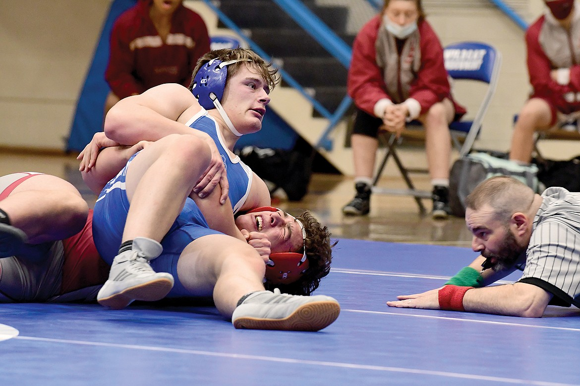 Wildcat sophomore Brandon Role pins Hamilton's Derrick Saltzman during a double-dual in Columbia Falls Tuesday evening. (Teresa Byrd/Hungry Horse News)