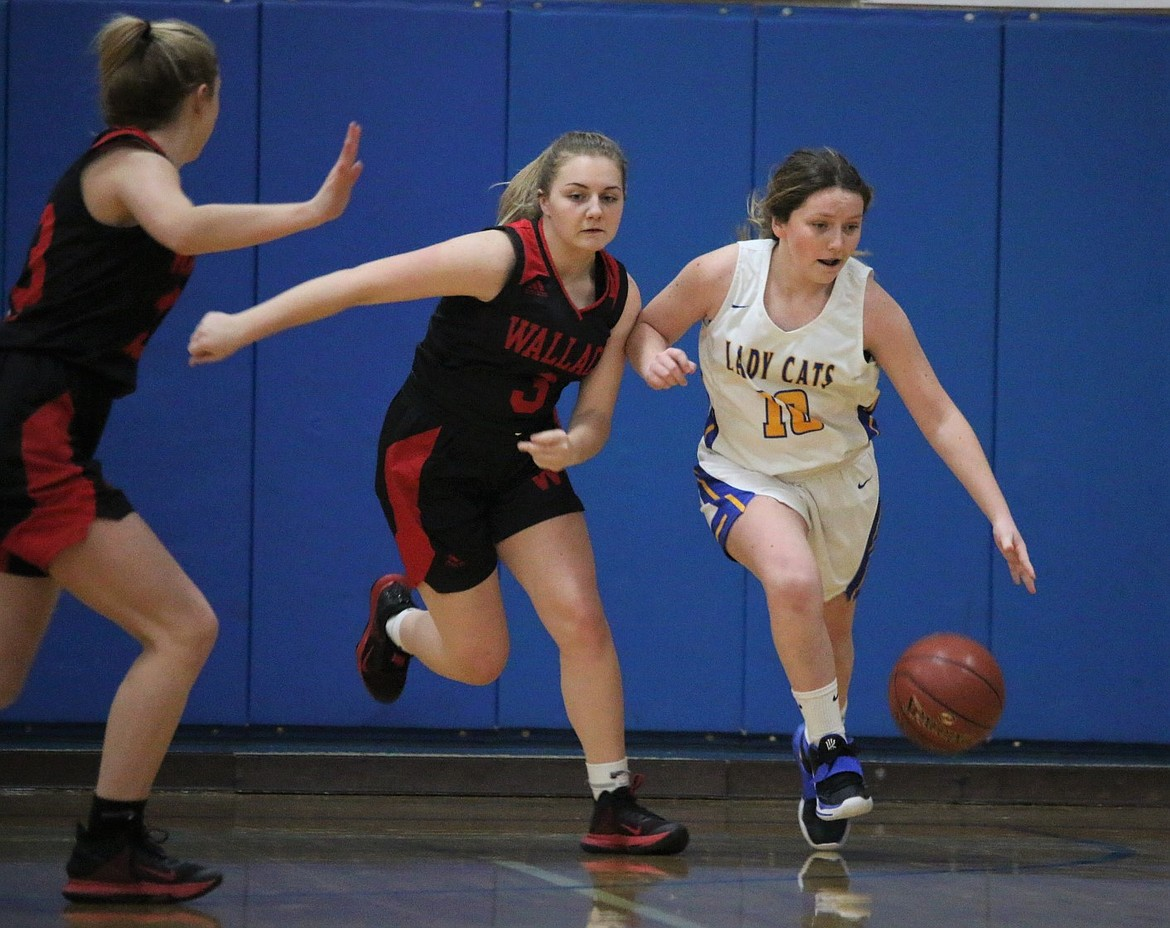 Freshman Lily Reuter (right) dribbles the ball up the court on Tuesday.