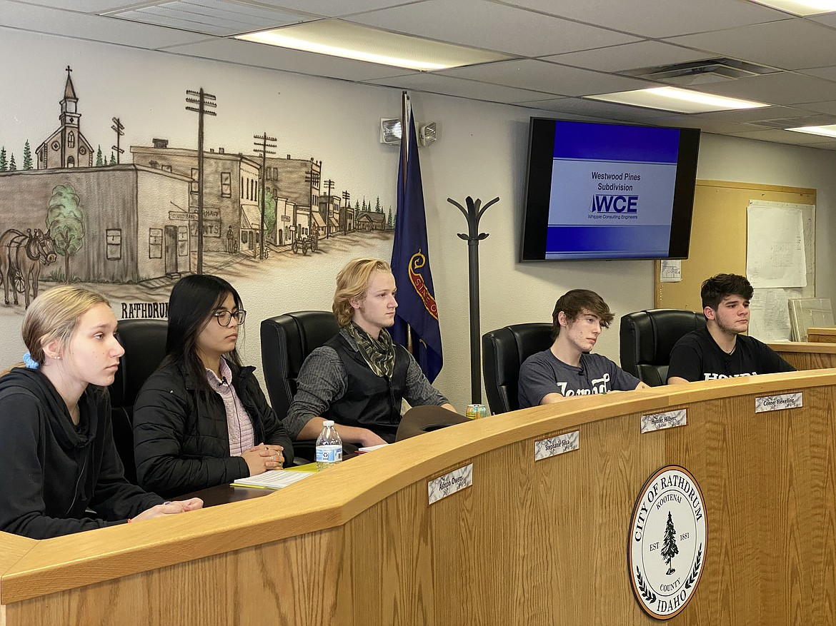 In a mock planning and zoning commission activity, 10 Mountain View High School seniors got a taste of local government operations Thursday afternoon at Rathdrum City Hall. From left: Ashton Owens, Stephanie Silva, Hunter Hilbert, Conner Fleweling and Dakota Gauthier. (MADISON HARDY/Press)