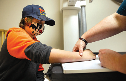 A walk-in patient receives and on-site X-Ray from Technician Tammy Dutton.