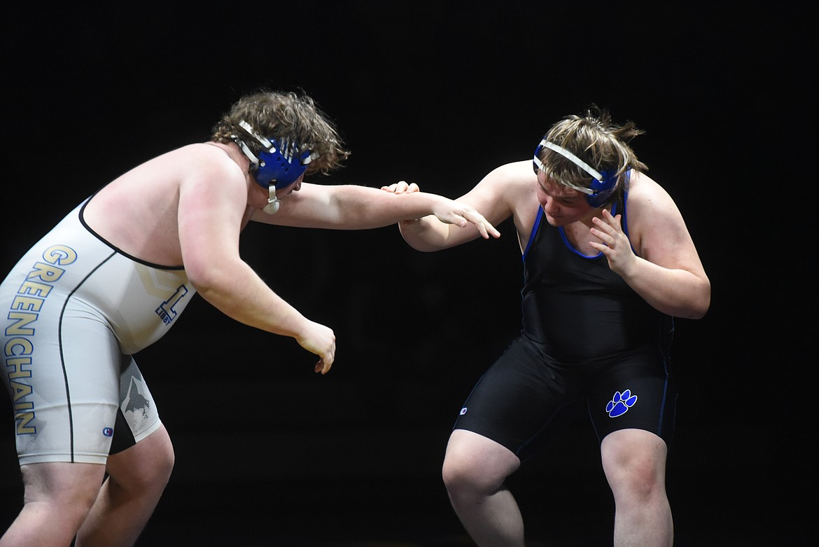 Libby junior Aydan Williamson looks for advantage against Wildcat Josh Price in the 285 pound category. (Will Langhorne/The Western News)