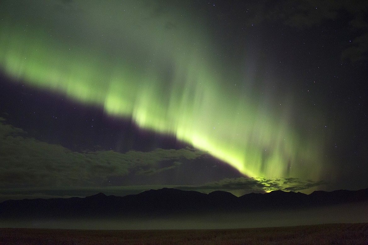 The aurora lights up the sky east of Bigfork. (Photo by Cassie Lasson and Drew Carter)