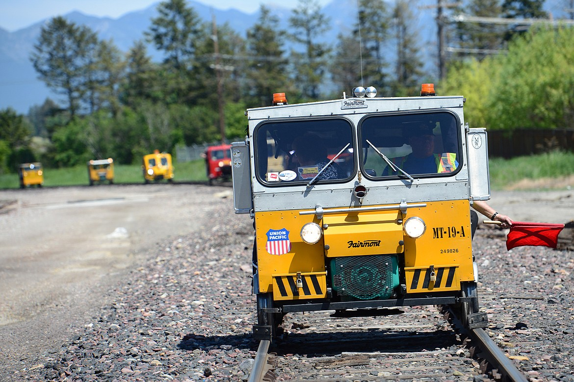 Passengers in rail cars tour a stretch of train tracks that will be removed for the future Kalispell Trail on Thursday, June 7, 2018. (Casey Kreider/Daily Inter Lake)