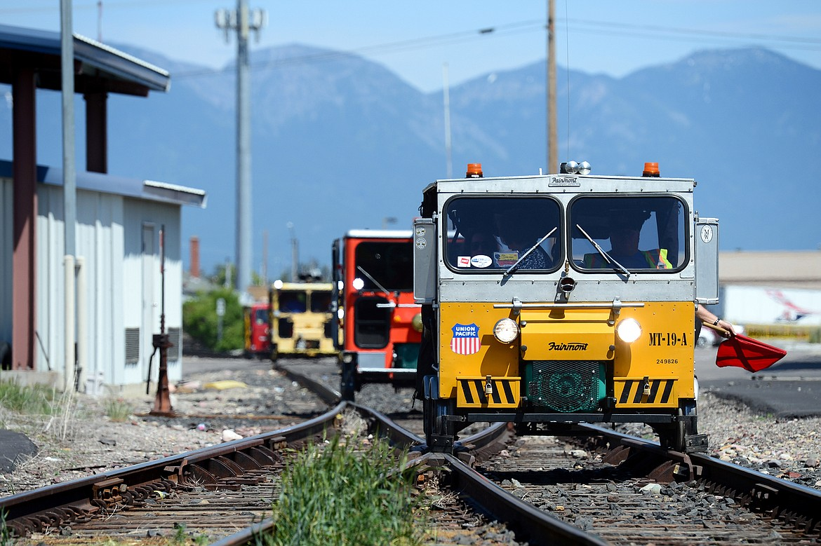 Passengers in rail cars tour a stretch of train tracks that will be removed for the future Kalispell Parkline Trail on Thursday, June 7, 2018. (Casey Kreider/Daily Inter Lake)