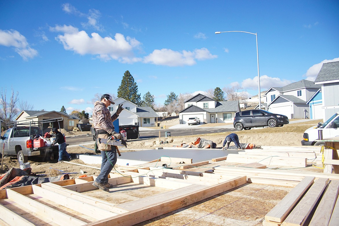 CAD Homes LLC employees laying the concrete for a garage on Alice Ave. in Royal City.