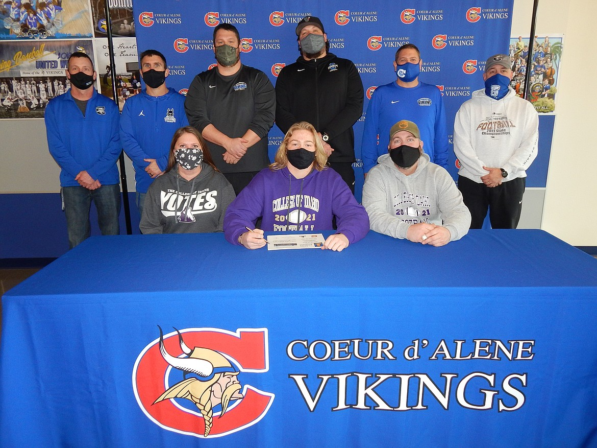 Courtesy photo Coeur d'Alene High senior Patrick O'Dell recently signed a letter of intent to play football at NAIA College of Idaho in Caldwell. Seated from left are Courtney Beach (mom), Patrick O'Dell and Matt O'Dell (dad); and standing from left, Bill White, Coeur d'Alene High assistant principal; Dustin Shafer, Coeur d'Alene High assistant football coach; Corey Brown, Coeur d'Alene High assistant football coach; Colin Donovan, Coeur d'Alene High assistant football coach; Brian Holgate, Coeur d'Alene High assistant football coach; and Shawn Amos, Coeur d'Alene High head football coach.